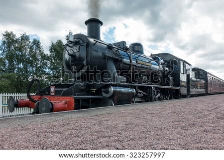 AVIEMORE, BADENOCH and STRATHSPEY/SCOTLAND - AUGUST 24 : Ivatt 46512 Locomotive at Aviemore Station Scotland on August 24, 2015. Unidentified man. - stock photo