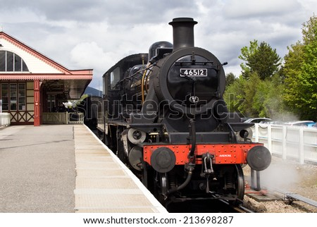 AVIEMORE, SCOTLAND - MAY 8: LMS Ivatt 46512 Class 2 2-6-0 locomotive, one of only seven remaining on May 8, 2014 in Aviemore, Scotland - stock photo