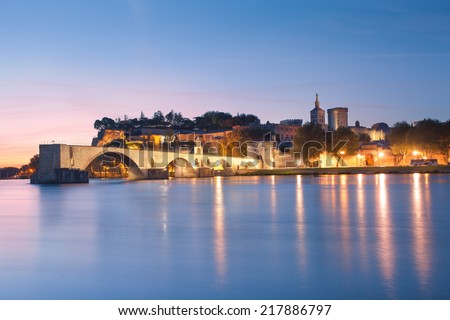 Avignon Bridge with Popes Palace and Rhone river at dawn, Pont Saint-Benezet, Provence, France - stock photo