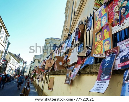 AVIGNON, FRANCE - JULY 18: Posters on the wall during annual Avignon Theater Festival, which in 2011 was attended by 450 theater companies in Avignon, France on July 18, 2011. - stock photo