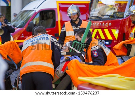 AVIGNON, FRANCE - OCTOBER 15: Local authority personnel demonstrate rescue operation activity at local fair in Avignon, France on October 15, 2013 - stock photo