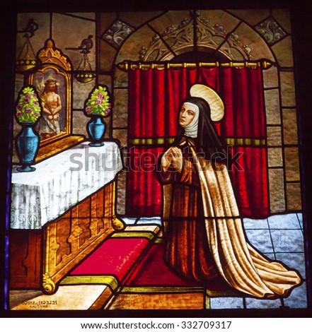 AVILA, SPAIN - MAY 10, 2014 Saint Teresa Praying to Jesus Stained Glass Convento de Santa Teresa Basilica Avila Castile Spain.  Convent founded in 1636 for Saint Teresa, Catholic nun. - stock photo