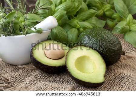 Avocado and avocado pieces  - stock photo