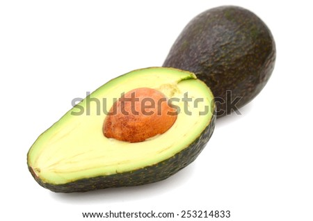avocado and half cut on white background - stock photo
