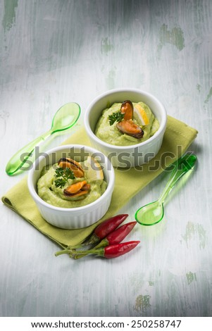 avocado cream with mussel appetizer - stock photo