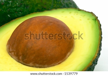 Avocado cut and whole, Green on it's side, isolated white background - stock photo