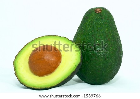 Avocado cut, Green on it's side, isolated white background - stock photo