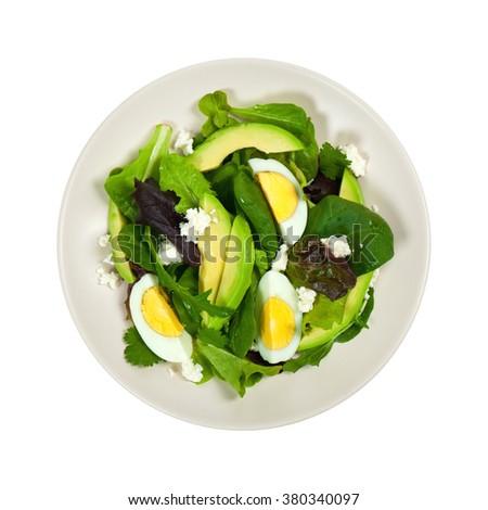 Avocado, Egg and Feta Salad Isolated on white background. Selective focus. - stock photo
