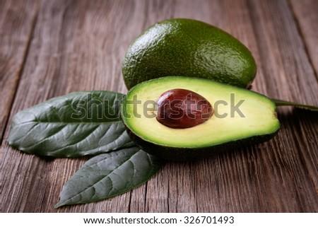 avocado on a dark wood background.  - stock photo