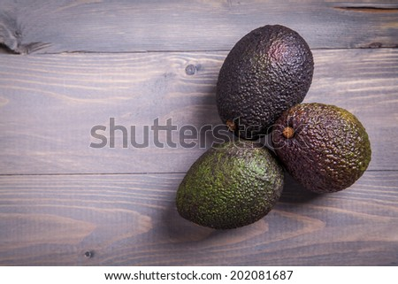 Avocado on a gray table - stock photo