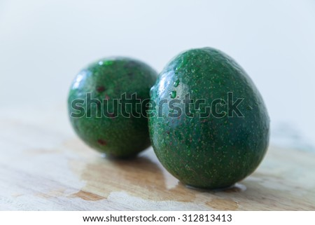 Avocado on a wood background - stock photo