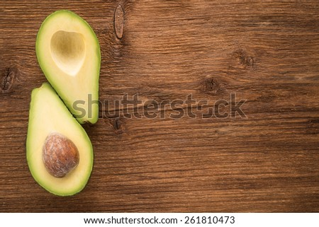 Avocado on a wooden background  - stock photo
