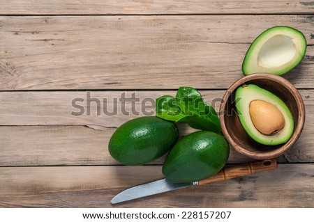 avocado on a wooden table old - stock photo