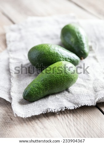 Avocado on the wooden table - stock photo