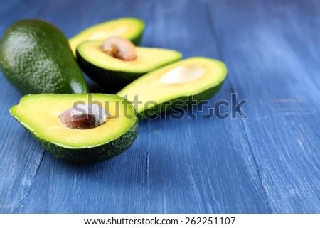 Avocado on wooden background - stock photo