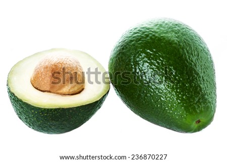 Avocado slice and whole ripe green avocado fruit  isolated on a white background. - stock photo