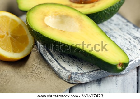 Avocado with lemon on table close up - stock photo