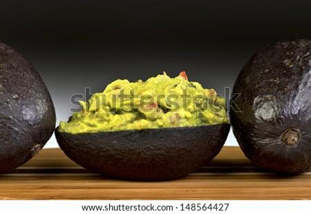 Avocados and Guacamole. - stock photo