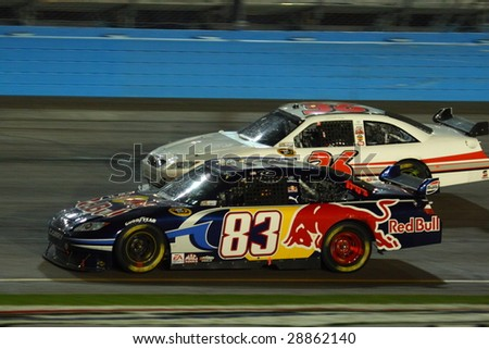 AVONDALE, AZ - APRIL 18: Brian Vickers (83) Red Bull Toyota drives into turn one of the NASCAR Sprint Cup Series race at Phoenix International Raceway on April 18, 2009 in Avondale. - stock photo