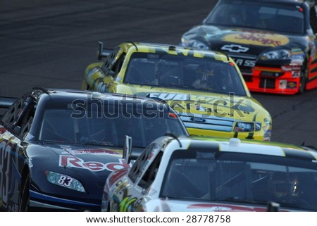 AVONDALE, AZ - APRIL 18: Brian Vickers works the No. 83 Red Bull Toyota in turn two of the NASCAR Sprint Cup Series race at Phoenix International Raceway on April 18, 2009 - stock photo