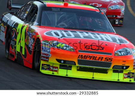 AVONDALE, AZ - APRIL 18: Jeff Gordon (24) hard at work in his Chevrolet during the NASCAR Sprint Cup Series race at Phoenix International Raceway April 18, 2009 in Avondale, AZ. - stock photo
