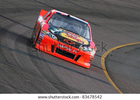AVONDALE, AZ - FEB 25: Jamie McMurray (1) at speed in a practice session for the SUBWAY Fresh Fit 500 race on Feb. 25, 2011 at the Phoenix International Raceway in Avondale, AZ. - stock photo