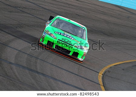 AVONDALE, AZ - FEB 25: Mark Martin (5) at speed in a practice session for the SUBWAY Fresh Fit 500 race on Feb. 25, 2011 at the Phoenix International Raceway in Avondale, AZ. - stock photo