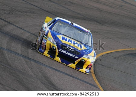AVONDALE, AZ - FEB 25: Martin Truex Jr. (56) at speed in a practice session for the SUBWAY Fresh Fit 500 race on Feb. 25, 2011 at the Phoenix International Raceway in Avondale, AZ. - stock photo