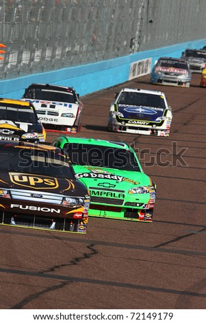AVONDALE, AZ - NOV 14: David Ragan (6) and Mark Martin (5) fight for position during the Kobalt Tools 500 race on Nov 14, 2010 at the Phoenix International Raceway in Avondale, AZ. - stock photo