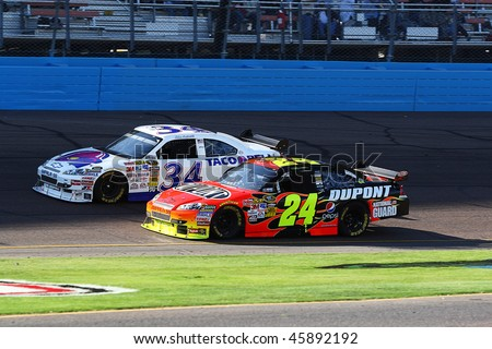 AVONDALE, AZ - NOV. 15:Jeff Gordon (24) and John Andretti (34) during the NASCAR Sprint Cup Series, Checker O'Reilly Auto Parts 500 at Phoenix International Raceway on Nov. 15, 2009 in Avondale, AZ. - stock photo