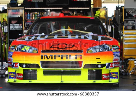 AVONDALE, AZ - NOV 12: Jeff Gordon's (24) Chevrolet sits in the garage before a practice session for the Kobalt Tools 500 race on Nov 12, 2010 at the Phoenix International Raceway in Avondale, AZ. - stock photo