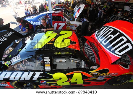 AVONDALE, AZ - NOV 13: Jeff Gordon's (24) crew works on his car before a practice session for the Kobalt Tools 500 race on Nov 13, 2010 at the Phoenix International Raceway in Avondale, AZ. - stock photo