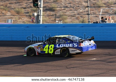 AVONDALE, AZ - NOV. 15:Jimmie Johnson (48) in the opening laps of the NASCAR Sprint Cup Series, Checker O'Reilly Auto Parts 500 at Phoenix International Raceway on Nov. 15, 2009 in Avondale, AZ. - stock photo