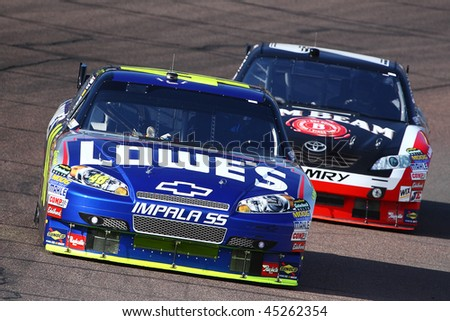 AVONDALE, AZ - NOV. 14: Jimmie Johnson leads Robby Gordon during a practice session for the NASCAR Sprint Cup race, at Phoenix International Raceway on Nov. 14, 2009 in Avondale, AZ. - stock photo