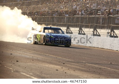 AVONDALE, AZ - NOV. 15:Jimmie Johnson (48) smokes the tires after winning the NASCAR Sprint Cup Series, Checker O'Reilly Auto Parts 500 at Phoenix Int. Raceway on Nov. 15, 2009 in Avondale, AZ. - stock photo