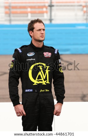 AVONDALE, AZ - NOV. 14: Josh Wise waits to qualify for the NASCAR Nationwide Series, Able Body Labor 200 at Phoenix International Raceway on Nov. 14, 2009 in Avondale, AZ. He qualified 27th. - stock photo