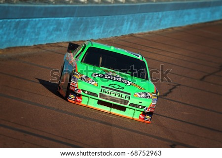 AVONDALE, AZ - NOV 12: Mark Martin (5) takes qualifying laps for the Kobalt Tools 500 race on Nov 12, 2010 at the Phoenix International Raceway in Avondale, AZ. - stock photo