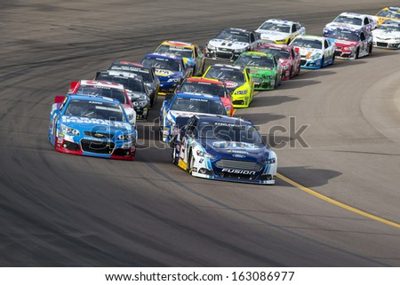 Avondale, AZ - Nov 10, 2013:  The NASCAR Sprint Cup teams take to the track for the AdvoCare 500 race at the Phoenix International Raceway in Avondale, AZ on Nov 10, 2013. - stock photo