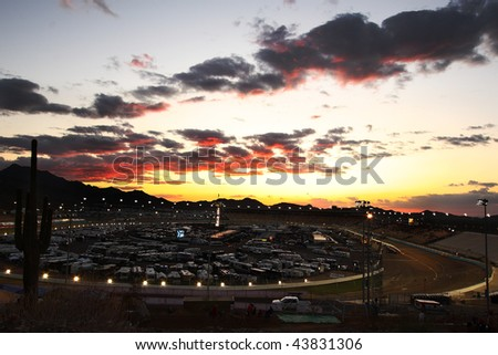 AVONDALE, AZ - NOV. 13: The sun sets at the track before the start of the NASCAR Camping World Truck Series Lucas Oil 150 at Phoenix International Raceway on Nov. 13, 2009 in Avondale, AZ. - stock photo