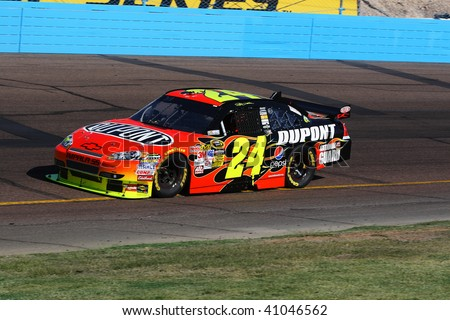 AVONDALE, AZ - NOVEMBER 15: Jeff Gordon (24) competes in the NASCAR Sprint Cup Series, Checker O'Reilly Auto Parts 500 at Phoenix International Raceway on November 15, 2009 in Avondale, AZ. - stock photo