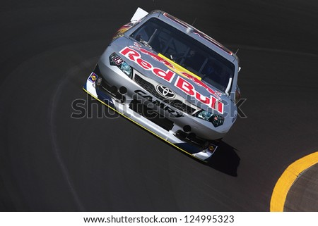 AVONDALE, AZ - OCT 5: Brian Vickers (83) takes hot laps during a NASCAR Sprint Cup track testing session on Oct. 5, 2011 at Phoenix International Raceway in Avondale, AZ. - stock photo