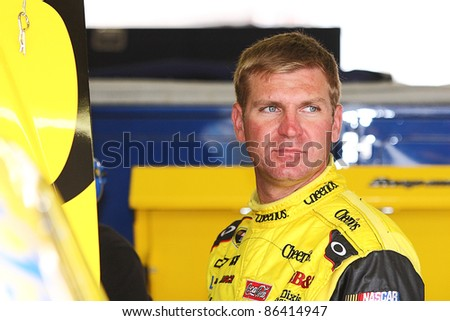 AVONDALE, AZ - OCT 4: Clint Bowyer (33) waits as the team make adjustments to his car during a track testing session on Oct. 4, 2011 at Phoenix International Raceway in Avondale, AZ. - stock photo