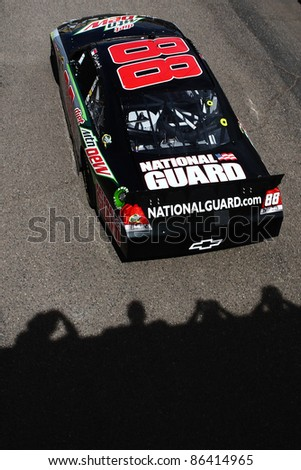 AVONDALE, AZ - OCT 4: Dale Earnhardt Jr. (88) heads to the track as fans look on during a track testing session on Oct. 4, 2011 at Phoenix International Raceway in Avondale, AZ. - stock photo