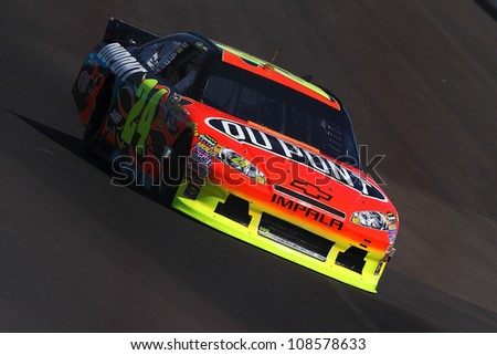 AVONDALE, AZ - OCT 5: Jeff Gordon (24) takes hot laps during a NASCAR Sprint Cup track testing session on Oct. 5, 2011 at Phoenix International Raceway in Avondale, AZ. - stock photo