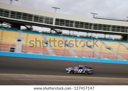 AVONDALE, AZ - OCT 4: Matt Kenseth (17) takes laps during a NASCAR Sprint Cup track testing session on Oct. 4, 2011 at Phoenix International Raceway in Avondale, AZ. - stock photo