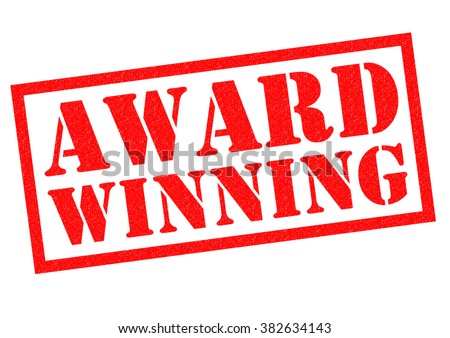 AWARD WINNING red Rubber Stamp over a white background. - stock photo