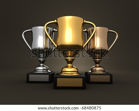 Awards - 3d rendered image of three trophies, gold, a silver and a bronze on a dark studio background - stock photo