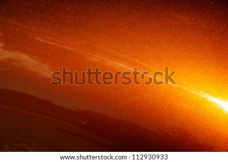 Awesome background: macro of muscle car metallic paint job, orange tone with sparkles. - stock photo