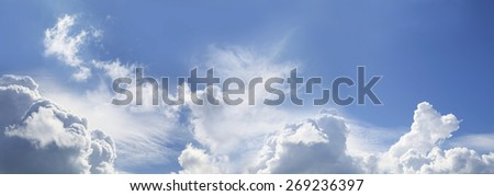 Awesome Blue Sky Panorama - Wide blue sky banner with various different fluffy clouds - stock photo