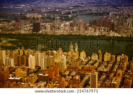 Awesome helicopter view of Jacqueline Kennedy Onassis Reservoir and Central Park with surrounding Skyscrapers - NYC. - stock photo